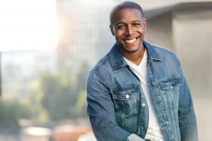 handsome black man modeling showing off attractive smile